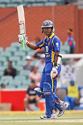 © Licensed to London News Pictures. 14/02/2012. Adelaide Oval, Australia. Sri Lankan batsman Dinesh Chandimal raises his bat after making 50  during the One Day International cricket match between India Vs Sri Lanka. Photo credit : Asanka Brendon Ratnayake/LNP