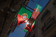A few days after Portugal's victory over France in the Euro 2016 tournament final, national flags still hang from various balconies in a narrow street in Bairro Alto, Lisbon, Portugal.