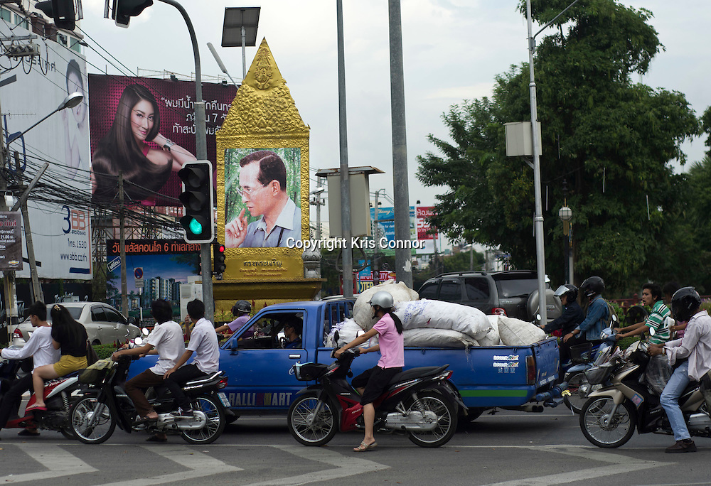 A portrait of the King can be scene at an intersection in Chiang Mai, Thailand. Photo by Kris Connor