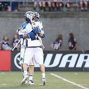 Ryan Young #27 of the Charlotte Hounds celebrates a goal with a teammate during the game at Harvard Stadium on May 17, 2014 in Boston, Massachuttes. (Photo by Elan Kawesch)