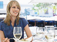 Woman eating meal at outdoor cafe