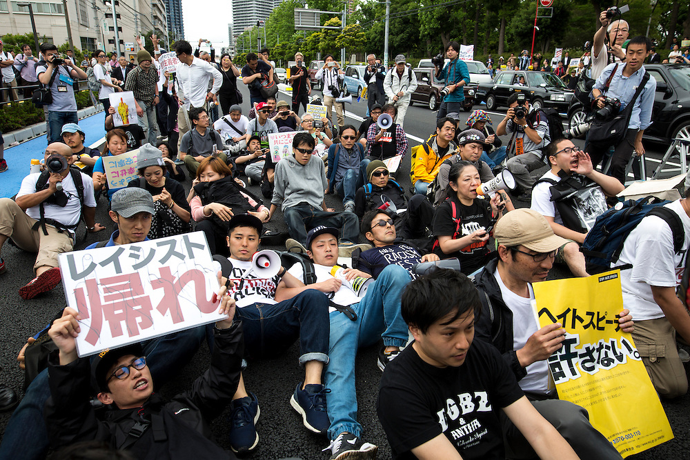 KAWASAKI, JAPAN - JUNE 05: Anti-fascist and anti-racist groups block several racist group from disrupting an counter-racist protest in Nakahara Peace Park, Kawasaki City, Kanagawa prefecture, Japan on June 5, 2016. A district court in Kanagawa Prefecture has issued a first-ever provisional injunction preventing an anti-Korean activist from holding a rally near the premises of a group that supports ethnic Korean people.<br /> <br /> Photo: Richard Atrero de Guzman