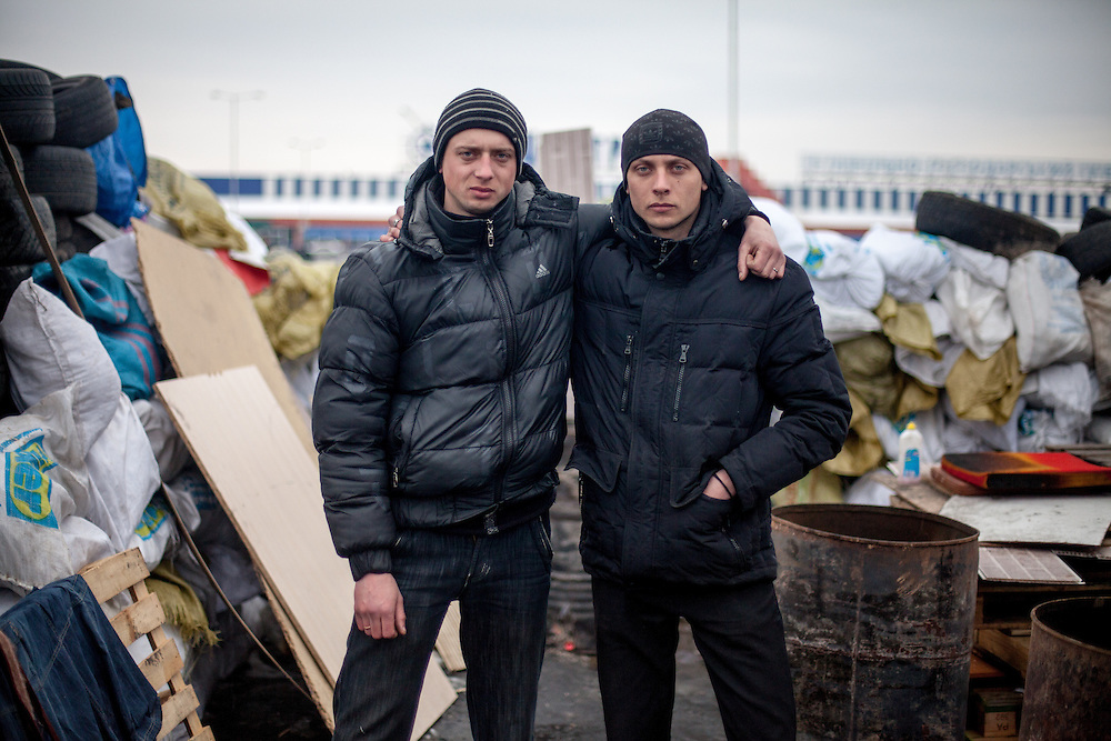 """Activists Andrej (right) and his brother at the barrikades blocking a building supplies store named """"Epicenter"""" in the city of Lviv, Ukraine."""