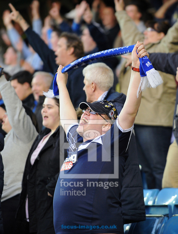 Picture by Seb Daly/Focus Images Ltd +447738 614630.23/04/2013.A Millwall fan celebrates his side taking the lead during the npower Championship match at The Den, London.