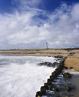 BB05925-02...NORTH CAROLINA - Waves crashing on the jetty near Cape Hatteras Lighthouse on the Outer Banks in Cape Hatteras National Seashore.
