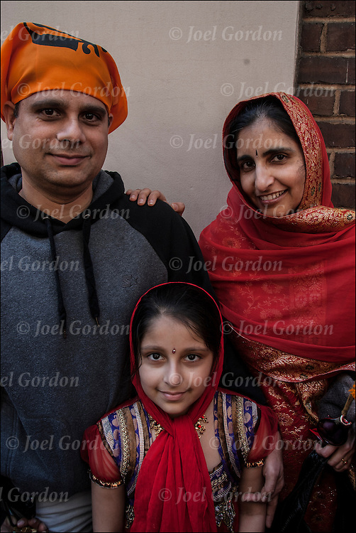 Portrait of  2nd generation Sikh-American family ( father, mother and third generation daughter) at the Sikh Day Parade in New York.