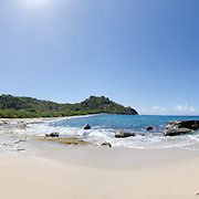 Windward Bay Beach Panoramic, Antigua, Falmouth Harbour, Caribbean. Morning walk along the beach, warm blue water and the sound of the waves on the sand.