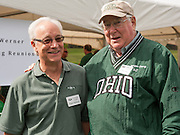 Hugh Sherman, College of Business Dean, interacts with Philip Muck outside of the College of Business tent at the Homecoming Tailgate 2013. Photo by Elizabeth Held