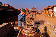 A man praying at the spot where once Vatsala Devi Temple stood before falling down during the earthquake of April 25, 2015. Bhaktapur, Nepal.