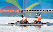 """Rio de Janeiro. BRAZIL. Gold Medalist NED LW2X. Bow. Ilse PAULIS, and Maaike<br /> HEAD, after winning the final, supporters swim out to greet and congratulate the double. 2016  2016 Olympic Rowing Regatta. Lagoa Stadium,<br /> Copacabana,  """"Olympic Summer Games""""<br /> Rodrigo de Freitas Lagoon, Lagoa. Local Time 10:39:07  Friday  12/08/2016 <br /> [Mandatory Credit; Peter SPURRIER/Intersport Images]"""