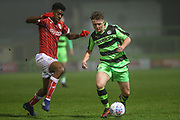 Forest Green Rovers Kieron Proctor(11) holds the ball up under pressure from Bristol City Tyreeq Bakinson(8) during the Gloucestershire Senior Cup match between Forest Green Rovers and U23 Bristol City at the New Lawn, Forest Green, United Kingdom on 9 April 2018. Picture by Shane Healey.