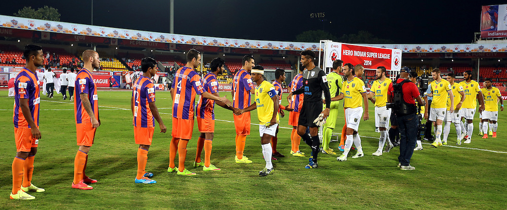 Players of Kerala Blasters FC and FC Pune City shakes hand before the start of the match 17 of the Hero Indian Super League between FC Pune City and Kerala Blasters FC held at the Shree Shiv Chhatrapati Sports Complex Stadium, Pune, India on the 30th October 2014.<br /> <br /> Photo by:  Sandeep Shetty/ ISL/ SPORTZPICS