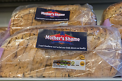 © Licensed to London News Pictures. 23/11/2018. London, UK.  'Mother's Shame' bread on a shelf inside the People's Vote campaign stunt pop-up shop in Peckham High Street on Black Friday to show that the government's Brexit deal is a bad deal and the shop is stocked with household products, such as 'chlorinated' chicken to illustrate the bad deal. Photo credit: Vickie Flores/LNP