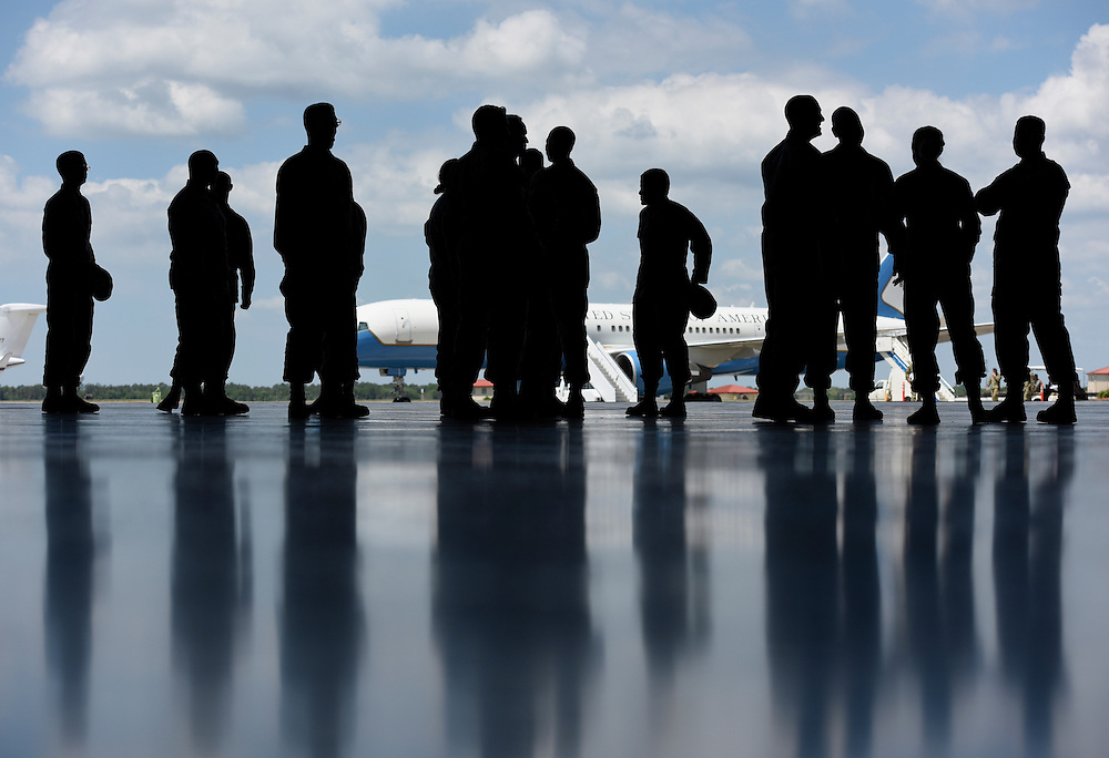 Soldiers are silhouetted against an open hangar door just prior to the United States Central Command Change of Command Ceremony Wednesday, March 30, 2016 at MacDill Air Force Base in Tampa. CHRIS URSO/STAFF
