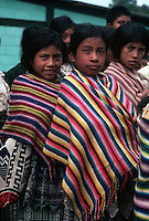 January 1983, Guatemala --- Guatemalan Indian children stand in line at a ceremony organized by the army to give the children some school items during the years of army repression in the 1980's. --- Image by © Owen Franken