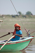 A man rows a sailing boat on the river Ganges in Uttar Pradesh, India