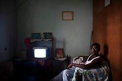 Santos Guity sits in his home on January 23, 2013  in Sambo Creek, Honduras.  Santos has HIV and is currently unemployed. Many people with HIV claim that they are unable to get a steady job because employers won't hire someone who has HIV. (David Rochkind/ Pulitzer Center)