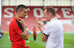 STOKE-ON-TRENT, ENGLAND - Sunday, August 9, 2015: Liverpool's Dejan Lovren chats with Stoke City's Charlie Adam before the Premier League match at the Britannia Stadium. (Pic by David Rawcliffe/Propaganda)