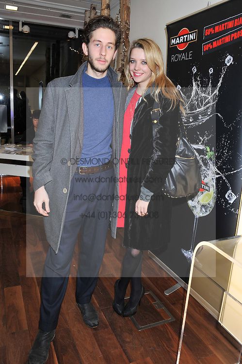 GRETA BELLAMACINA and JACOB PERLMUTTER at a party to celebrate the launch of the Casio Tokyo watch in association with Flashtrash.com held at itsu, 10a Blandford Road, London W1 on 28th January 2013.