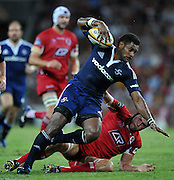 Sireli Naqelevuki is brought to ground after a strong run in the 1st half during action from Round 11 of the Super 14 Rugby Union match between the Queensland Reds and the South African Stormers played at Suncorp Stadium on Friday 23 April 2010 ~ ©Image Aura Images.com.au ~ Conditions of Use: This image is intended for Editorial use as news and commentry in print, electronic and online media ~ For any alternative use please contact AURA Images.com.au