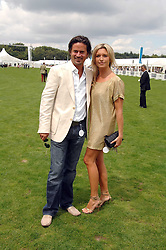 Actress TINA HOBLEY and her husband OLIVER WHEELER at the Cartier International polo at Guards Polo Club, Windsor Great Park on 29th July 2007.<br />