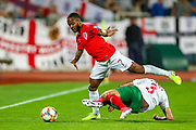 Bulgaria defender Petar Zanev with a wild challenge on England forward Raheem Sterling during the UEFA European 2020 Qualifier match between Bulgaria and England at Stadion Vasil Levski, Sofia, Bulgaria on 14 October 2019.