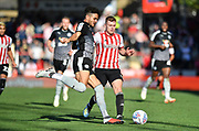 Brentford midfielder Lewis Macleod (4) and Reading defender Tiago Ilori (20) during the EFL Sky Bet Championship match between Brentford and Reading at Griffin Park, London, England on 29 September 2018.