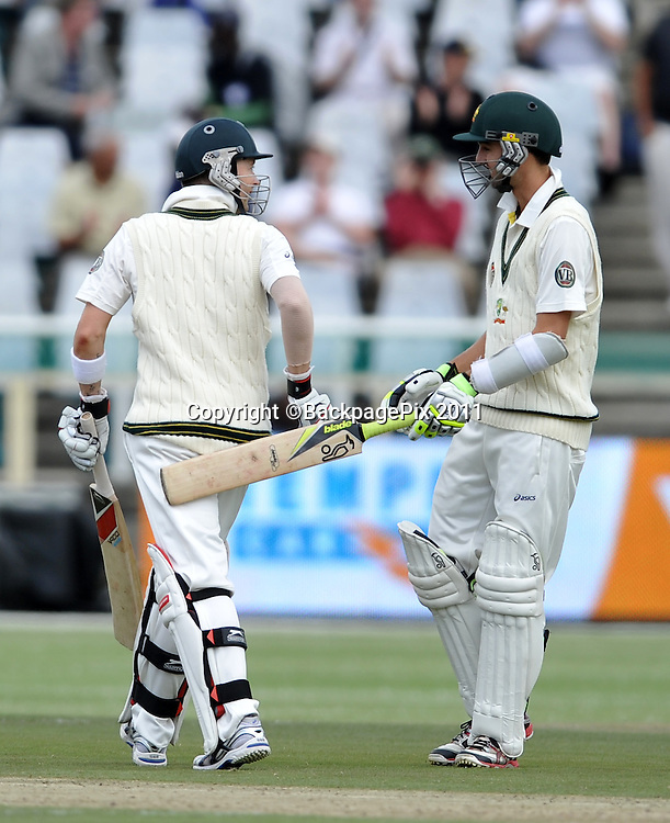 Michael Clark (captain) of Australia is congratulated by teammate Nathan Lyon after going to 150. South Africa v Australia, first test, day 2, Newlands, South Africa. 10 November 2011<br /> <br /> <br /> &copy;Ryan Wilkisky/BackpagePix