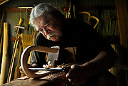 *HOLD FOR STORY BY SAMANTHA GROSS**<br /> In this photo taken July 19, 2010, Alf E. Jacques makes a wooden lacrosse stick on his carving bench at the Onondaga Nation, N.Y.  Jacques has been a traditional stick maker for 47 years. &quot;It's who we are as a people, the Creator's game,&quot; said Jacques of the game of lacrosse.  Living uneasily among Americans, many Iroquois still believe they're fighting for their own identity.<br /> (AP Photo/Heather Ainsworth)