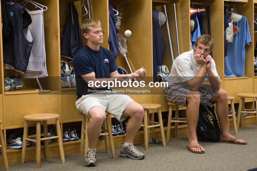 11 October 2007: North Carolina Tar Heels men's lacrosse senior Andrew Moss and freshman Emmit Kellar in the locker room in Chapel Hill, NC.