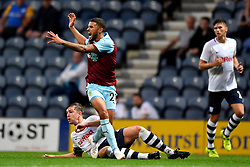 Burnley's Nahki Wells is tackled by Preston North End's captain Paul Huntington during a pre season friendly match at Deepdale, Preston.