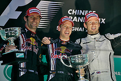 SHANGHAI, CHINA - Sunday, April 19, 2009: Mark Webber (AUS, Red Bull Racing), Sebastian Vettel (GER, Red Bull Racing) and Jenson Button (GBR, Brawn GP) on the podium after the Formula One Grand Prix of China at the Shanghai International Circuit. (Pic by Michael Kunkel/Hoch Zwei/Propaganda)