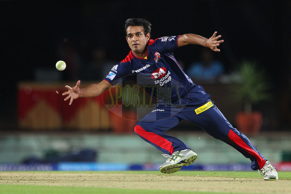 Siddarth Kaul fields from his own bowling during match 67 of the Pepsi Indian Premier League between The Kings XI Punjab and the Delhi Daredevils held at the HPCA Stadium in Dharamsala, Himachal Pradesh, India on the on the 16th May 2013..Photo by Ron Gaunt-IPL-SPORTZPICS ..Use of this image is subject to the terms and conditions as outlined by the BCCI. These terms can be found by following this link:..http://www.sportzpics.co.za/image/I0000SoRagM2cIEc