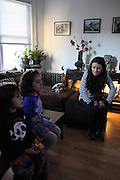 Kearny, New Jersey. November 19, 2013. Yadira Aleman watches her son and niece watch TV in her living room in Kearny. Photo by Maya Rajamani/NYCity Photo Wire