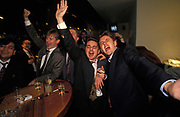 A group of young men sing karaoke at Coates Wine Bar on London Wall in the City of London, the capital's financial district, on 18th December 1993, in London, England.
