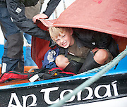 18/08/2013 Seven year old local Alfie Dwyer shelters on An Tonai a Galway Hooker during  the annual Crinniu na mBad (The Gathering of the boats) Festival in the picturesque village of Kinvara Co. Galway. Picture:Andrew Downes