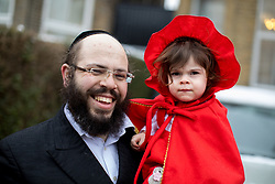 © Licensed to London News Pictures. 01/03/2018. London, UK. An Orthodox Jew and his daughter celebrate the festival of Purim in the streets of Stamford Hill in north London. Purim is celebrated by Jewish communities around the world with parades, parties in costume and the exchange of gifts. The event is documented in the Book of Esther, and commemorates the defeat of Haman, the advisor to the Persian king, and his plot to massacre the Jewish people 2,500 years ago. Photo credit : Tom Nicholson/LNP
