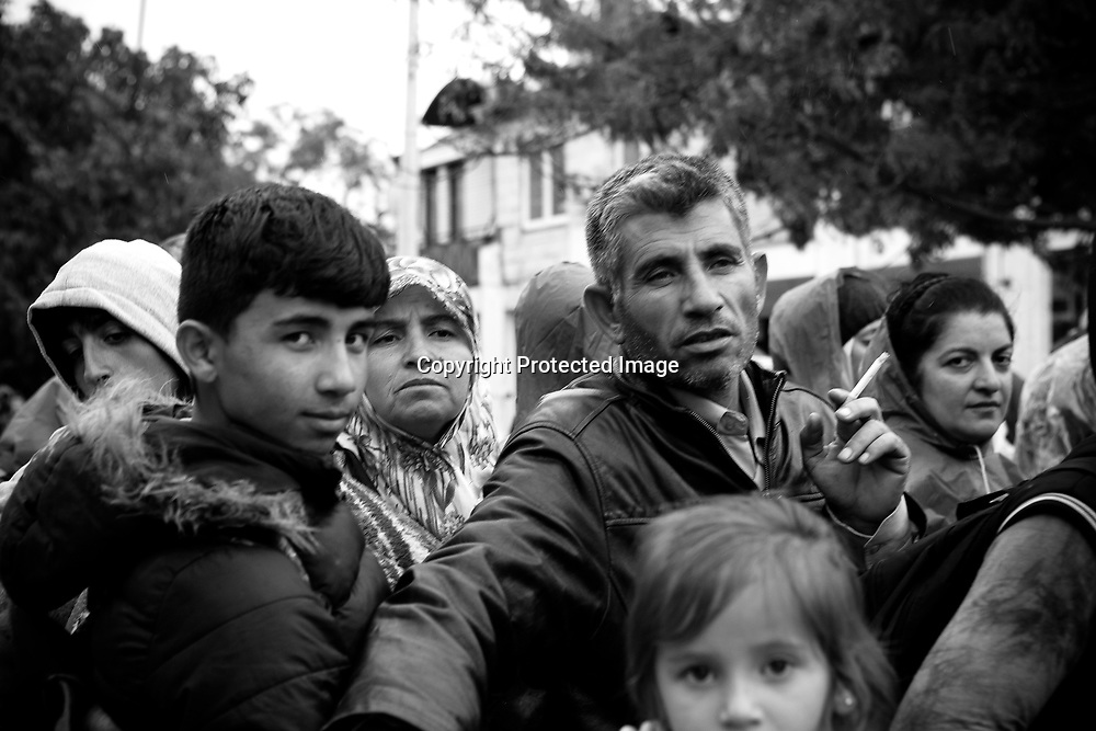 Immigrants and or refugees wainting to register in Presevo, Serbia. They just arrived from Macedonia and they must register before they proceed to the next stop in Sid - a small town in the border with Croatia.