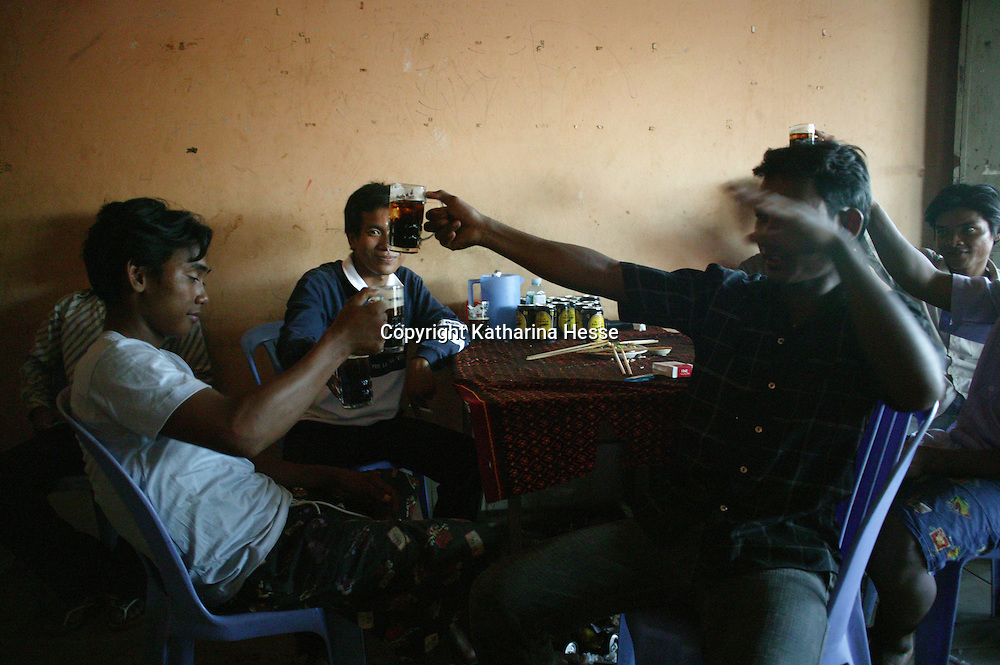 SIEM REAP, NOVEMBER-28: young men drink in the afternoon in a restaurant in Siem Reap, November 28, 2006, Cambodia.