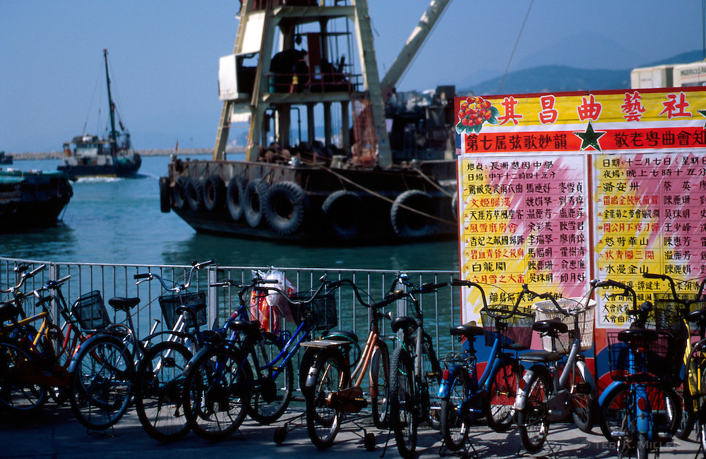 Bicycles line the pier on Cheung Chau Island, Hong Kong, China.