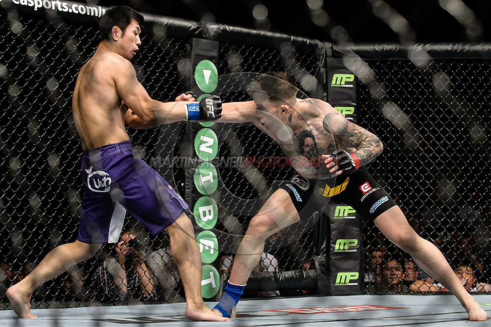 """DUBLIN, IRELAND, JULY 19, 2014: Action in and around the cage during """"UFC Fight Night: McGregor vs. Brandao"""" inside the O2 in Dublin, Ireland on Saturday, July 19 (© Martin McNeil)"""