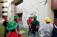 Researchers examine a large crack on the campus of the Universidad Autónoma de Baja California. A group of researchers led by Dr. Benson Shing, Vice Chair of the Department of Structural Engineering at the University of California, San Diego, inspected the earthquake damage in Mexicali, Mexico, April 7, 2010. A 7.2 magnitude earthquake in Baja California on Easter Sunday was felt as far away as Los Angeles.