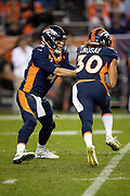 Denver Broncos quarterback Case Keenum (4) hands off the ball on a running play to Denver Broncos rookie running back Phillip Lindsay (30) in the fourth quarter during the NFL week 4 regular season football game against the Kansas City Chiefs on Monday, Oct. 1, 2018 in Denver. The Chiefs won the game 27-23. (©Paul Anthony Spinelli)