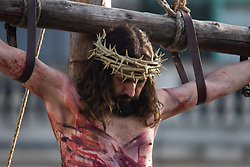 Trafalgar Square, London, March 25th 2016. Thousands of Londoners an tourists in Trafalgar Square are treated to The Passion of Jesus, a re-enactment of the events leading up to the crucifixion and resurrection of Jesus Christ. PICTURED: Jesus slumps, dead on the cross. <br /> &copy;Paul Davey<br /> FOR LICENCING CONTACT: Paul Davey +44 (0) 7966 016 296 paul@pauldaveycreative.co.uk