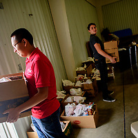 Family, Career & Community Leaders of America volunteers Tery Charlie, left, and Michael Gonzales tote boxes of groceries for community members in  the First Baptist Church in Grants Thursday.