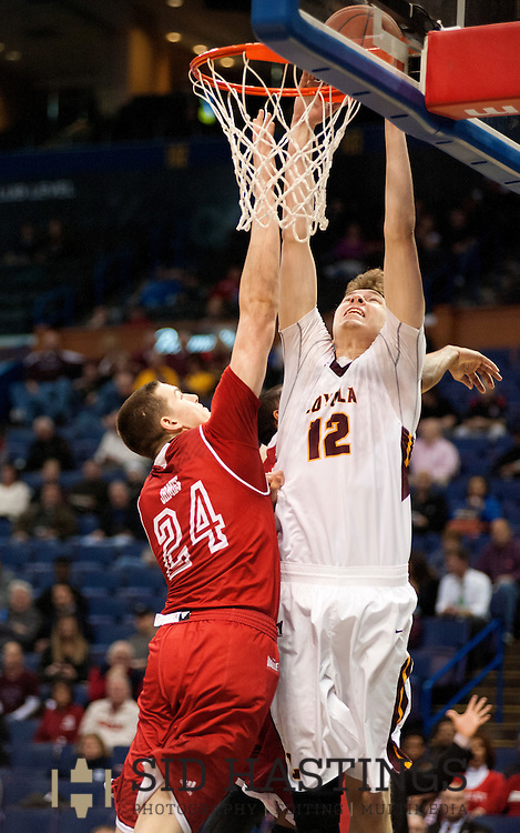 3 MARCH 2016 -- ST. LOUIS -- Loyola University Chicago's men's basketball player Julius Rajala (12) scores over Bradley University defender Scottie James (24) during the 2016 Missouri Valley Conference Arch Madness men's basketball tournament at the Scottrade Center in St. Louis Thursday, March 3, 2016. The Ramblers topped Bradley 74-66, to advance to the second round of the tournament.<br /> <br /> Photo &copy; copyright 2016 Sid Hastings.