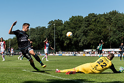 (L-R) Reuven Niemeijer of Heracles Almelo, goalkeeper Kjell Scherpen of FC Emmen during the Friendly match between Heracles Almelo and FC Emmen at Sportcomplex 't Brook on July 14, 2018 in Bornerbroek, The Netherlands