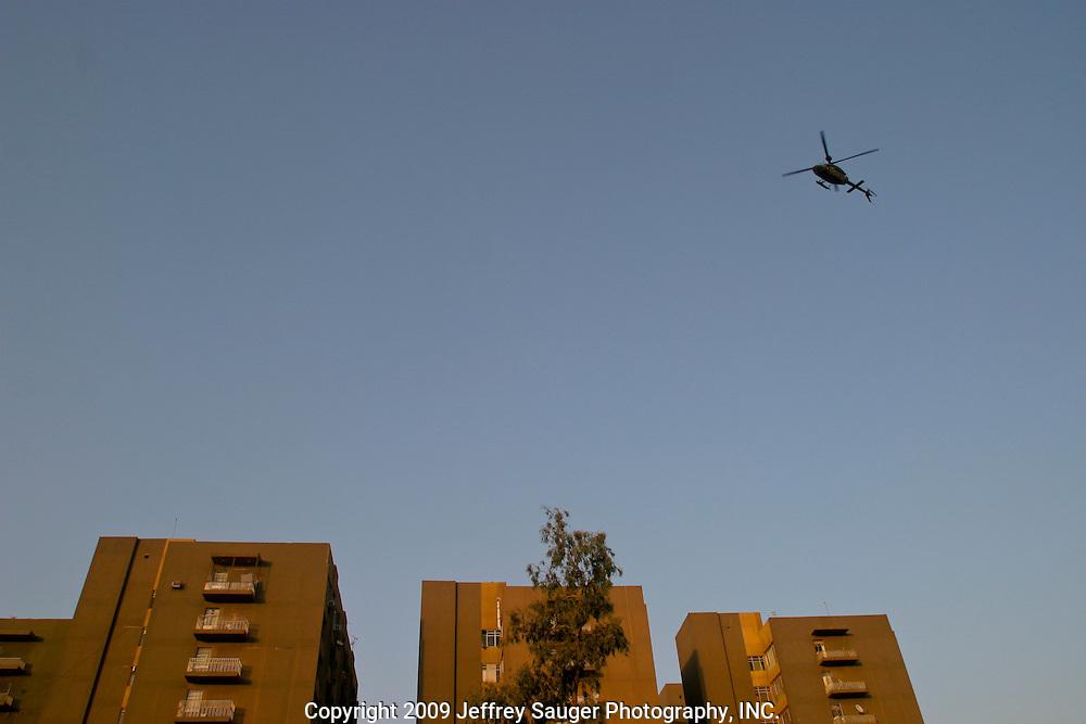 Helicopter flies near Palestine Hotel in Baghdad, Iraq.