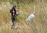 Exclusive<br /> Scotland Yard forensic technician mapping a place where there have seen abnormal evidence in the ground a tent will be erected around this plot today, Praia da Luz where do searches through the body of Maddie McCann.<br /> ©Exclusivepix