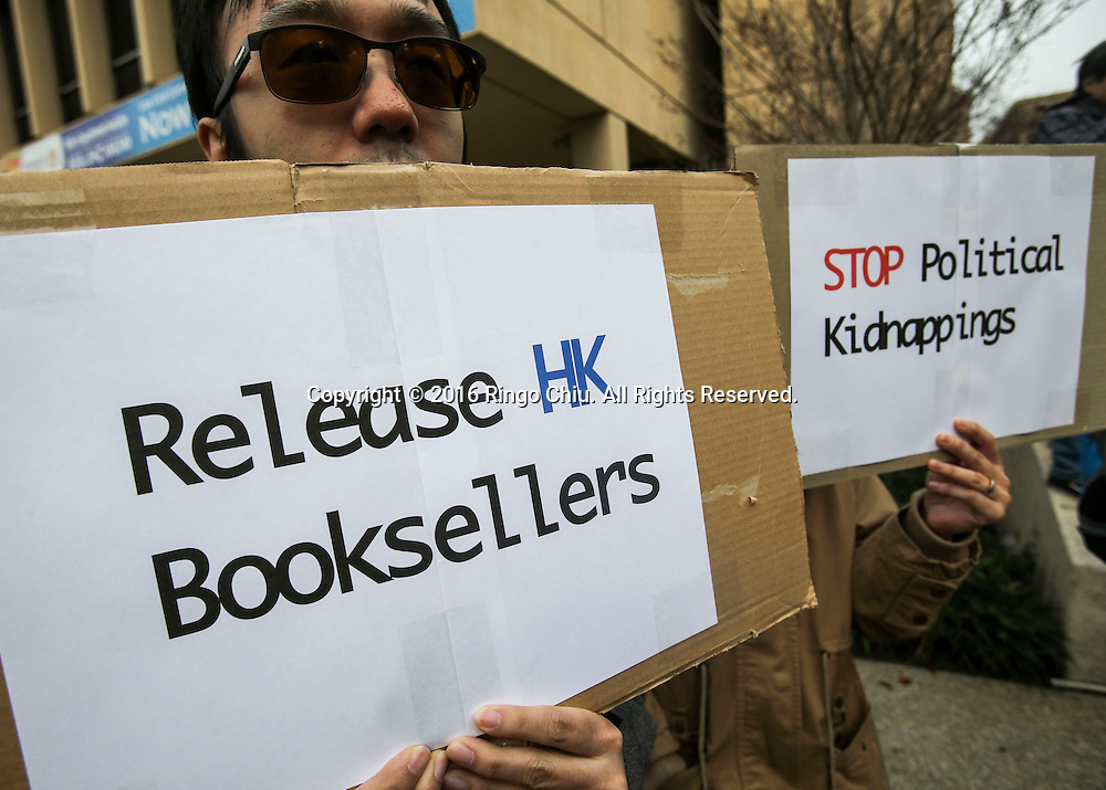 A group of Chinese protest against the disappearances of Hong Kong booksellers, outside the Consulate General of The People's Republic of China, on January 10, 2016 in Los Angeles. The disappearance of five Hong Kong booksellers, including UK passport holder Lee Bo, has sent shivers through Hong Kong as anxiety grows that Chinese control over the city is tightening.(Photo by Ringo Chiu/PHOTOFORMULA.com)<br /> <br /> Usage Notes: This content is intended for editorial use only. For other uses, additional clearances may be required.